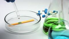 Alkaline liquid on a test strip in petri dish Stock Footage