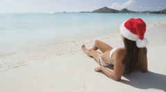 Christmas beach woman in santa hat on holidays Stock Footage