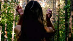 Woman girl tying her hair before running jogging in park, wood, forest Stock Footage