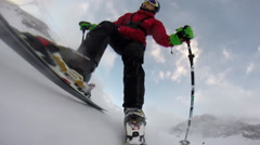 POV of a young man skiing down a snow covered mountain. Stock Footage