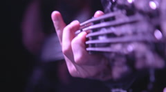 Closeup bassist hand playing the bass guitar in concert Arkistovideo