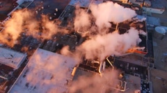 Aerial view of scenic industrial zone with smokestacks, early morning. Stock Footage