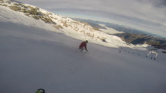 Young man skiing down a snow covered mountain. Stock Footage