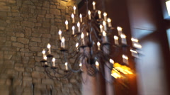 A chandelier hanging from the ceiling of a hotel resort in the mountains. Arkistovideo
