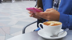 Urban professional business woman texting smart phone using app drinking coffee Stock Footage