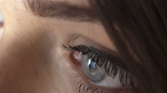 Scrolling the pages of facebook: reflection in the eyes of a young woman  Stock Footage