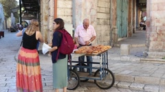 Old man selling bread at local market in Jerusalem Stock Footage