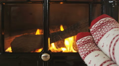 Feet In Warm Socks By Fireplace In Winter Having a Cozy Time Relaxing Stock Footage