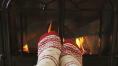 Woman Feet In Socks Relaxing Warming by Fireplace Getting Warm Relaxing Stock Footage