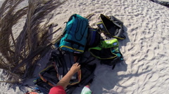 POV of a young kite surfer walking on the beach with equipment. Stock Footage