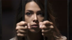 Attractive young woman held in prison: imprisonment, sentence, without freedom Stock Footage