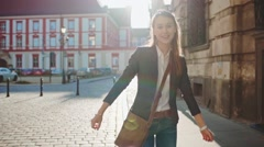 Happy Businesswoman Funky Dancing on the Sunny Street. SLOW MOTION STEADICAM Stock Footage