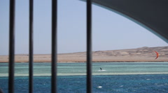 Looking at kite surfers through a ships window. Stock Footage