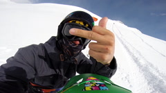 POV of a man kiteboarder giving the camera the middle finger. Stock Footage
