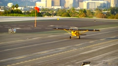 SANTA MONICA, CALIFORNIA USA - OCT 07, 2016: airplane landing on runway Stock Footage