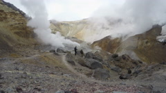 People hiking in crater of active volcano (4k, time lapse) Stock Footage