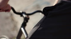 Close-up of a young man gripping the handle bars of his bike. Stock Footage