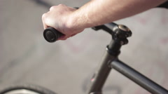 Tracking shot of a young man riding his bicycle on a bike path by a creek. Stock Footage