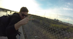 POV of friends riding bicycles together on a bike path by a creek at sunset. Stock Footage