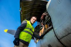 Mechanic near airplanes engine Stock Photos