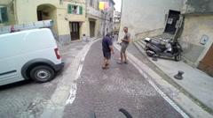POV of a man biking through the streets of a small European town. Stock Footage
