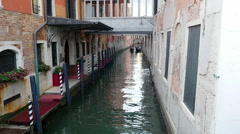 Narrow venice canal with gondolas in Venice, Italy Stock Footage