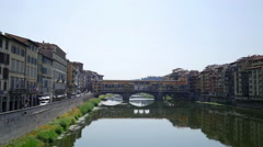 Arno River and Ponte Vecchio bridge in Florence, Italy Stock Footage