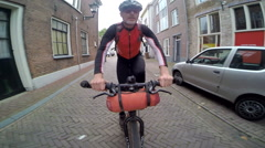 POV of a man biking on the streets of a European town. Stock Footage