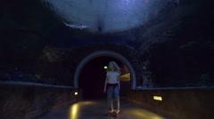 Girl Walks Through Underwater Tunnel, Sharks Swim Above, Looks Around In Wonder Stock Footage