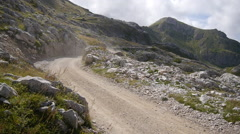 A man mountain biking on a European mountainside biking trail. Stock Footage