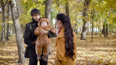 Husband and wife after work in the woods to spend time with your child Stock Footage