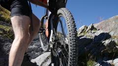 A man carrying his bike on a European mountain biking trail. Stock Footage