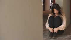 Sad and depressed lonely woman sitting on the ground Stock Footage