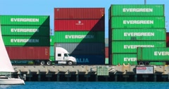 Trucks move cargo containers at the sea port in Los Angeles port 4K RAW Stock Footage