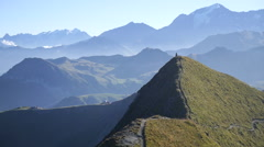 A man mountain biking across a European mountain range. Stock Footage