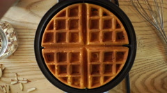 Waffle cooking on wooden table, 4K Stock Footage