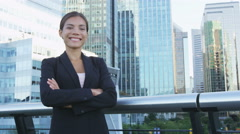 Happy business woman portrait of young female urban professional businesswoman Stock Footage
