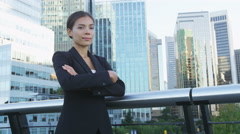 Business woman portrait of young female urban professional businesswoman in suit Stock Footage