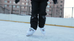 Close up front view at children legs in white plastic hockey skates riding Stock Footage