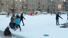 Russian kids and parents sledge down from ice-hill with inflatable sledges. Rus Stock Footage