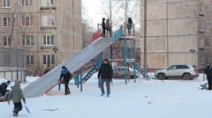 Russian kids slide down from ice-hill on inflatable sledges. Winter in Russia Stock Footage