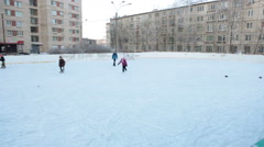 Hockey and ice rink is near wooden ice-hill in the inner area of district city Stock Footage