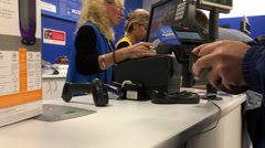 Man returning heater at customer service counter inside Walmart store Stock Footage