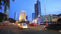 Night traffic in Jakarta business district Stock Footage