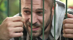 Jailed desperate Man cries Stock Footage