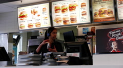Worker cleaning tray on counter inside A&W restaurant Stock Footage