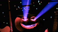 Portrait of Halloween pumpkin with blue light shining through the pumpkin Stock Footage