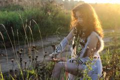 Girl clothes amazon nature sunset Stock Photos