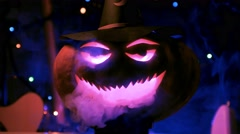 Close-up of big Halloween pumpkin in the lights and smoke of the club Stock Footage
