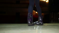 Young woman legs in shiny boots dancing on stage Stock Footage